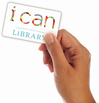 hand holding library card
