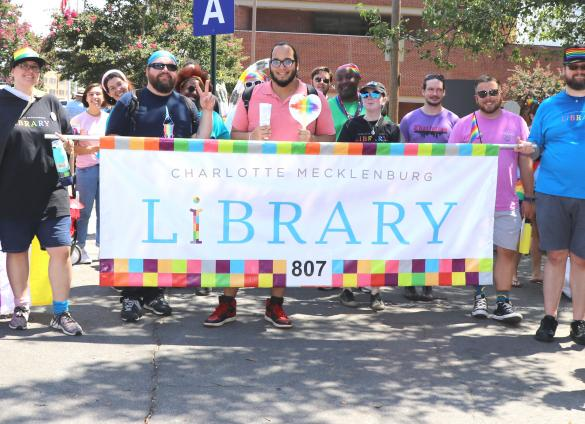 Charlotte Mecklenburg Library staff, family and friends participated in the Charlotte Pride parade on August 18, 2019.