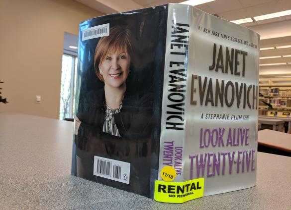 Writer Janet Evanovich returns with the newest in her comic, mystery bounty hunter series marking number 25, entitled Look Alive Twenty-Five, in its books titled by the number format.