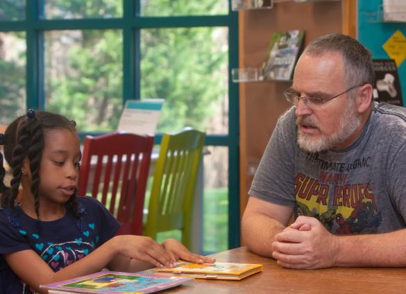 Adult volunteer reading buddies help kids read