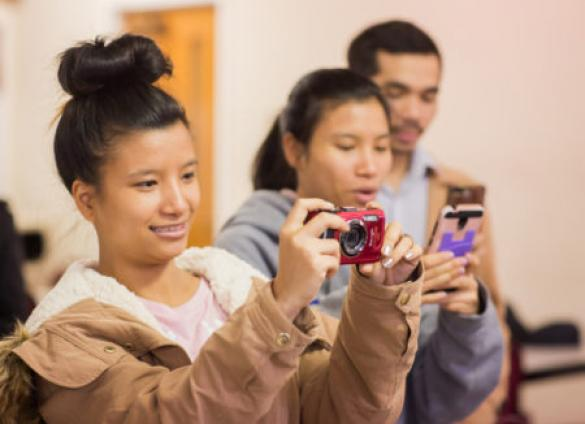 Participants learn camera techniques in Finding Home Again