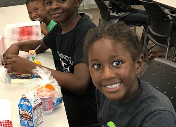 Children enjoy lunch at West Boulevard Library thanks to the Summer Food Service program, a partnership with Charlotte Mecklenburg Schools