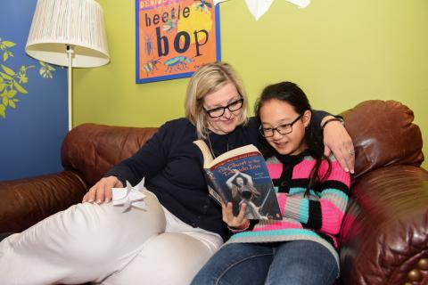 Reading buddies read together at Charlotte Mecklenburg Library.