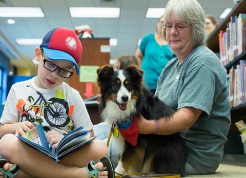 Paws to Read pairs pups with young readers