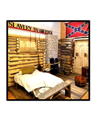 The Slave Cabin installation is a sectional replica of interior housing of the period with examples of household materials and cooking equipment used at the time.