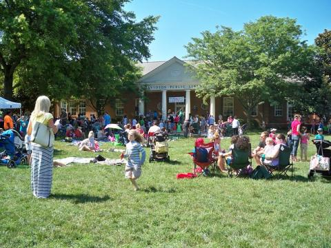 Charlotte Mecklenburg Library customers enjoy summer time at Davidson Library in Davidson, North Carolina