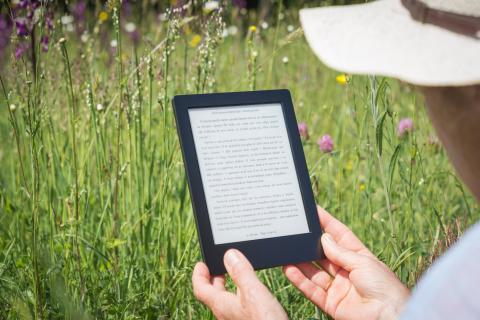 Person reading an ebook on a mobile device.